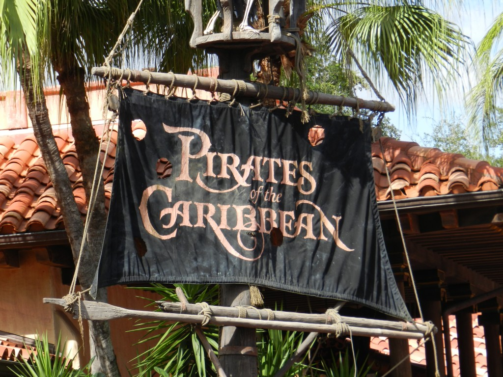 Pirates of the Caribbean ride entrance with pirate black flag post.
