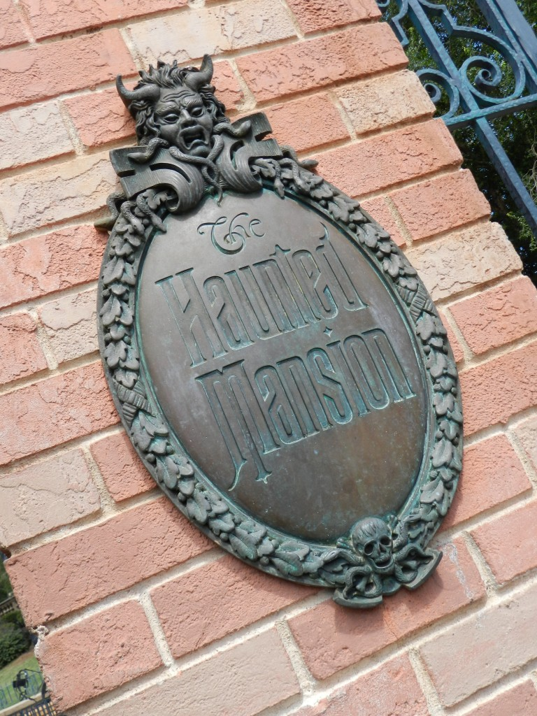 Join the happy haunts on the Haunted Mansion at the brick gate ride entrance in Magic Kingdom.