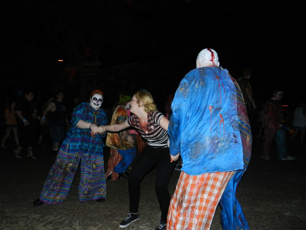 Howl-O-Scream Busch Gardens Tampa Bay. Zombie clowns taking away Busch Gardens worker.