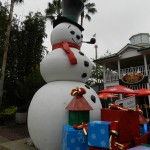 SeaWorld Orlando Christmas Celebration with Snowman in front of gifts.