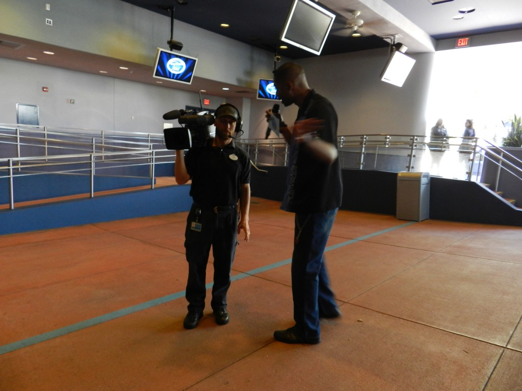 American Idol Experience Disney with Cast Member recording video footage.