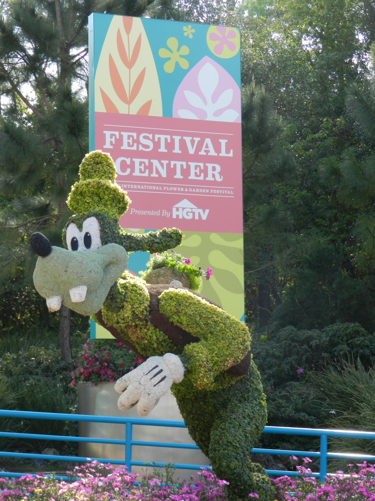EPCOT Flower Garden Festival 2013 Festival Center entrance with Goofy topiary.