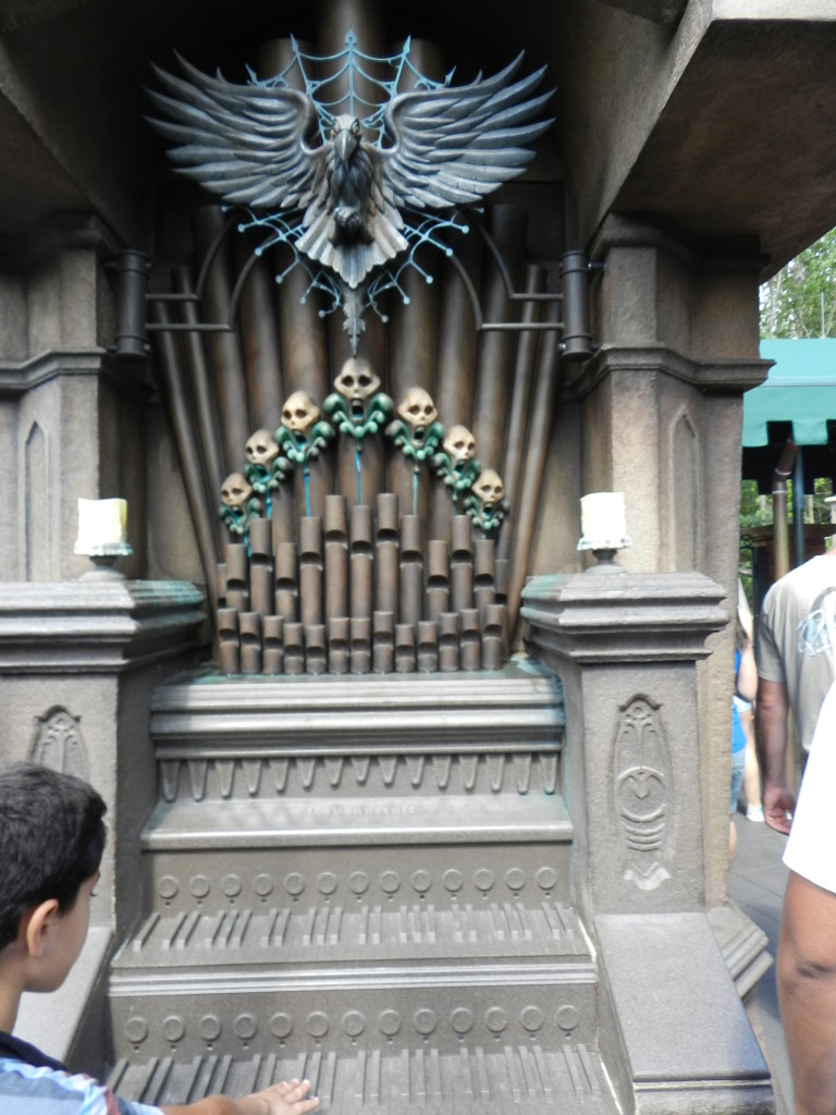 Haunted Mansion Magic Kingdom Secrets at Disney with Organ covered in Skulls.
