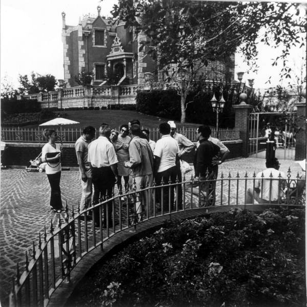 Tourist group near Haunted Mansion at the Magic Kingdom - Orlando, Florida in 1971.