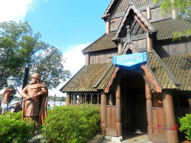 Norway Pavilion in Epcot at Disney with Viking in front of Stave House.