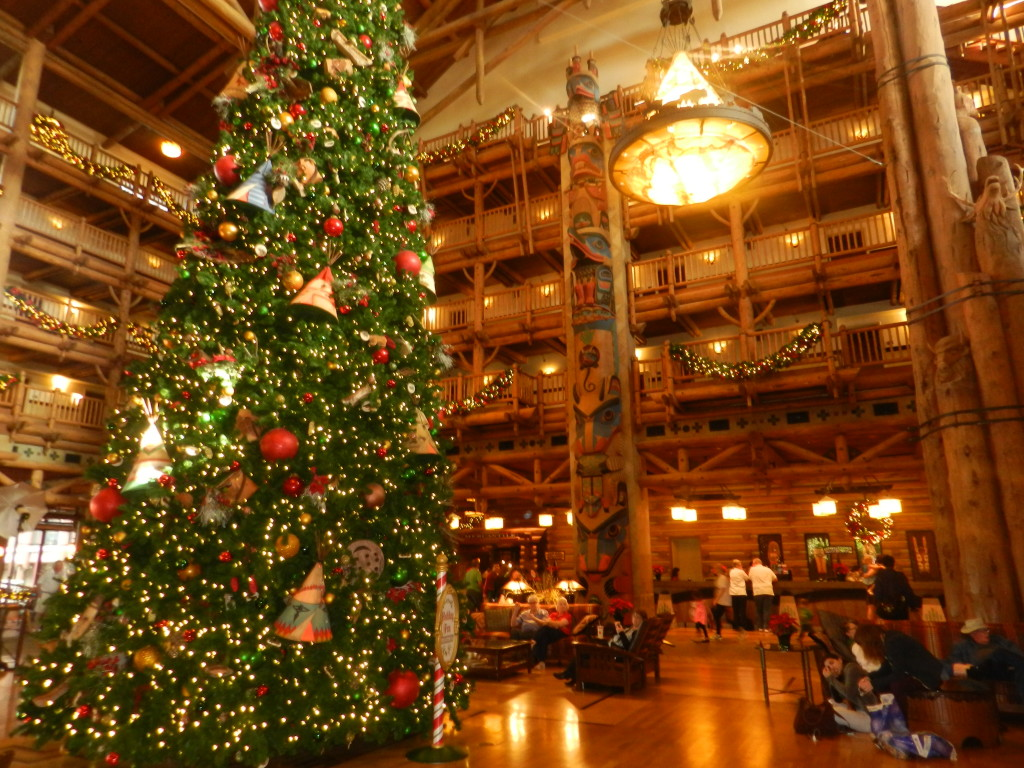 Christmas at Ft. Wilderness Lodge huge lobby with wooden beams and fireplaces