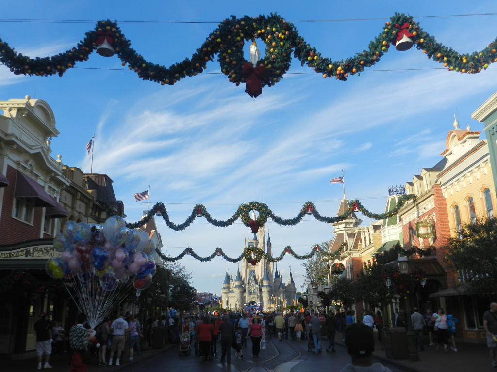 Holidays at the Magic Kingdom on Main Street U.S.A with Cinderella Castle in the Distance. Christmas at Disney World.
