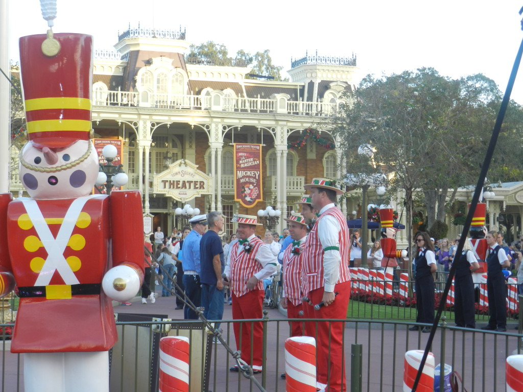 Christmas at Walt Disney World with red and white toy soldiers and Dapper Dans singing on Main Street U.S.A.