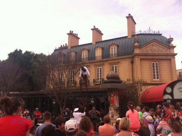 Chefs de France Disney World Epcot Theme Park With Performer on Top Chair in front of Restaurant