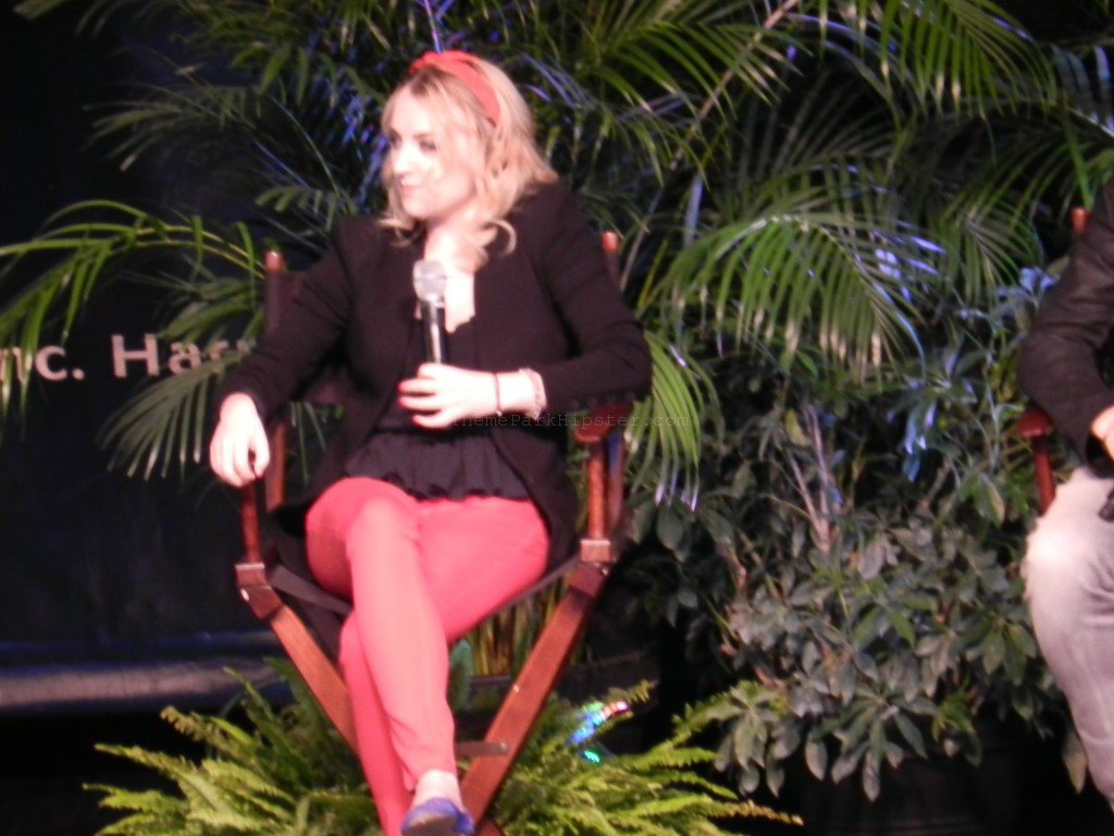 Evana Lynch during the Q&A session sitting on stage at Islands of Adventure