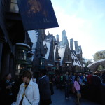 Wizards and witches gathering in Hogsmeade at the Hog's Head Inn