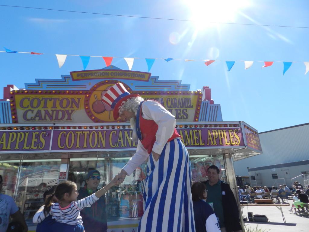 Uncle Sam on Stilts Greeting Kids.