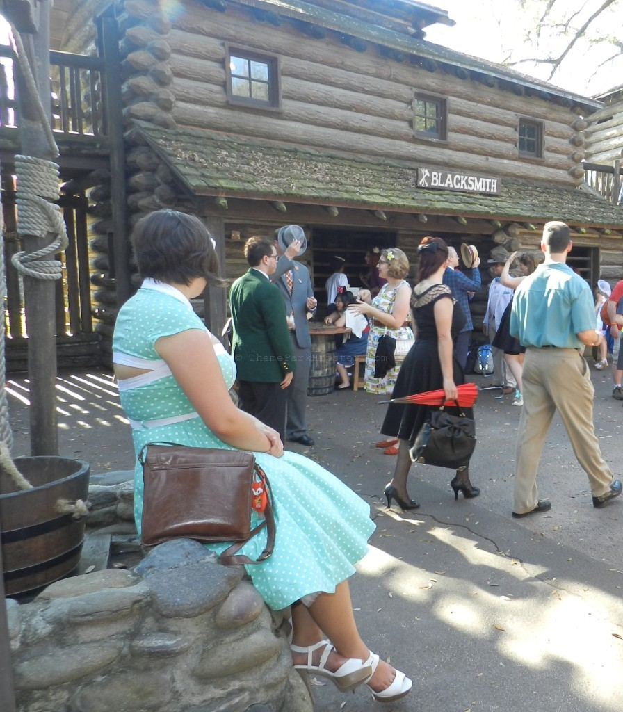 Tom Sawyer Island with lady dressed in Dapper Day polka dotted dress at the Magic Kingdom