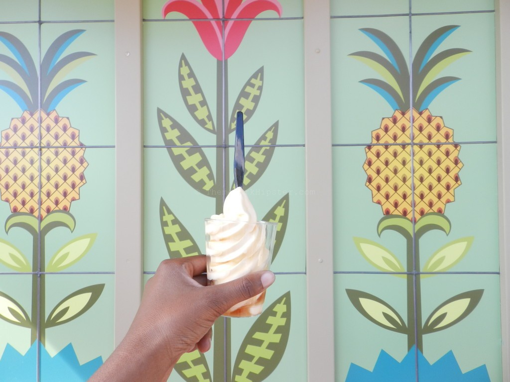 Dole Whip in many variations in front of pineapple painted wall at Disney World.