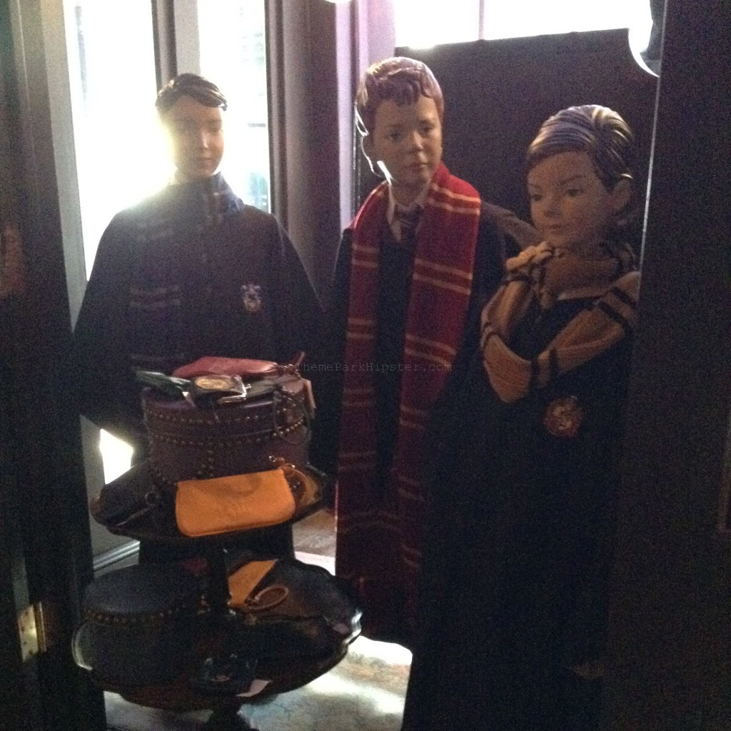 Madam Malkin's store in Diagon Alley with Hogwarts students in robs.