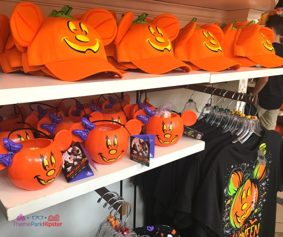 Disney Halloween Merchandise with orange mickey mouse pumpkin jack-o-lantern face on hat. Get them before your trip. Easy ways to do Disney World on a budget.