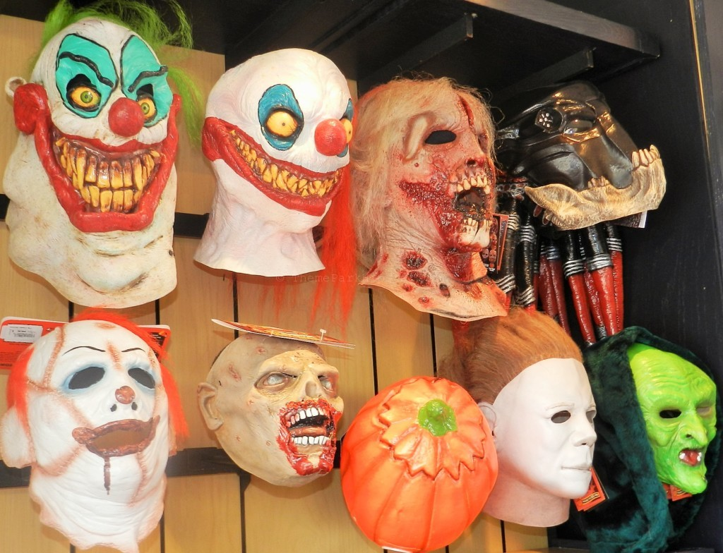 Halloween Horror Nights Tips Survival Guide with scary clown mask and green face witch mask.
