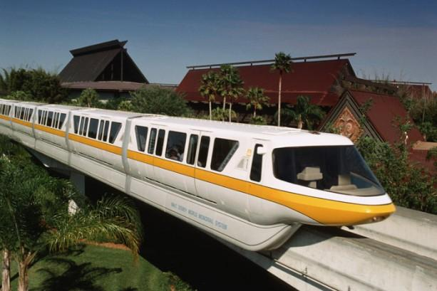 Disney's Monorail riding in front of the Polynesian Resort. One of the best Disney World tips is to use the monorail to resort hop.