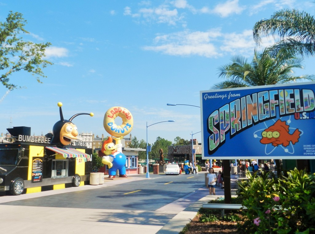 Welcome to Springfield sign next to yellow and black Bumblebee Food Truck and Cletus' Chicken Shack
