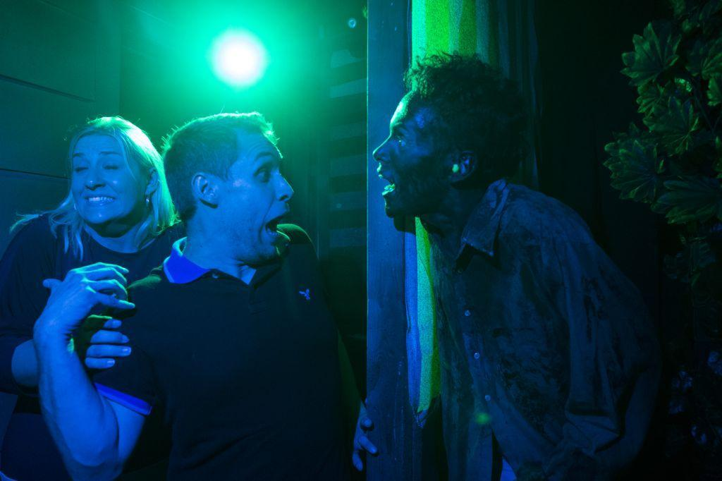 Halloween Horror Nights Tips Survival Guide with zombie scaring guests.