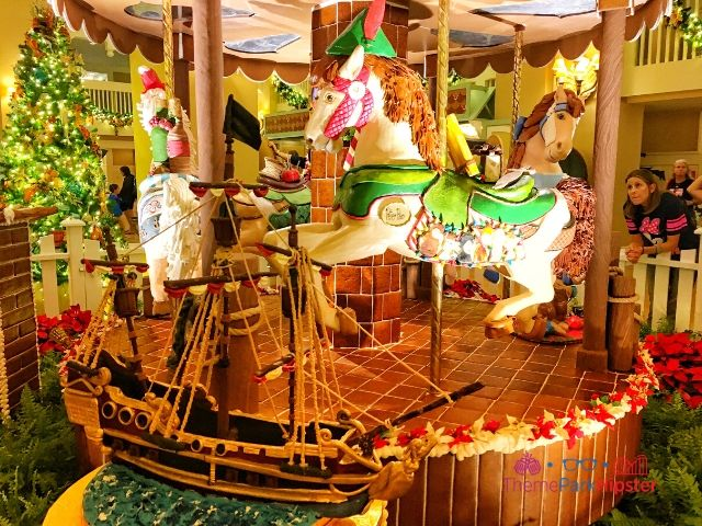 Disney Gingerbread House Carousel with Peter Pan horse and Captain Hook cake boat in front at Beach Club Resort.