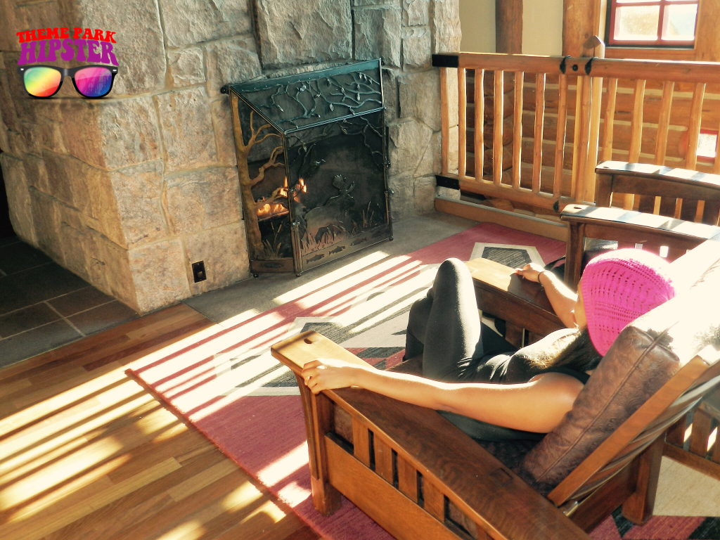 Relaxing by the rustic fireplace at Disney's Wilderness Lodge NikkyJ of ThemeParkHipster