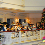 Christmas at Disney's Grand Floridian Resort and Spa with live band playing holiday tunes.