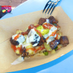 Epcot Flower and Garden Festival Beef Brisket Burnt Ends Hash with White Cheddar Fondue and Pickled Jalapenos