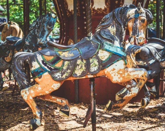 Abandoned amusement park carousel ride