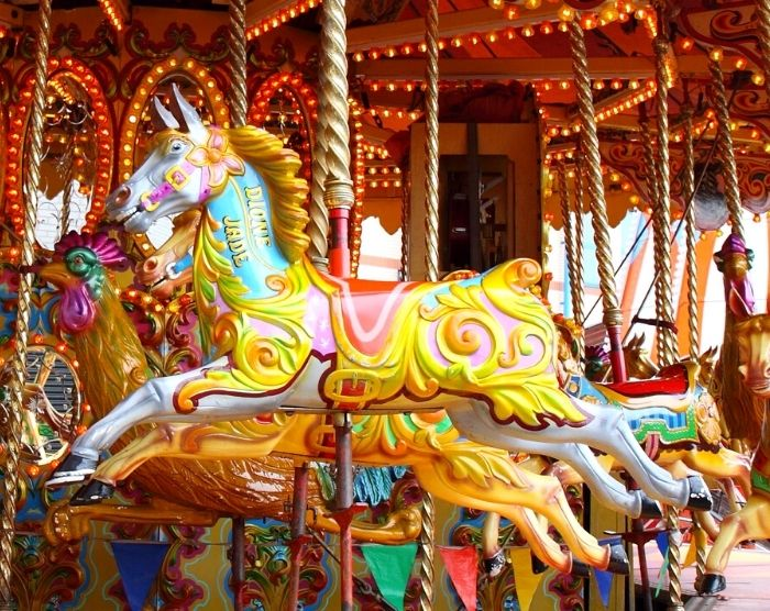 Amusement park carousel ride with horses