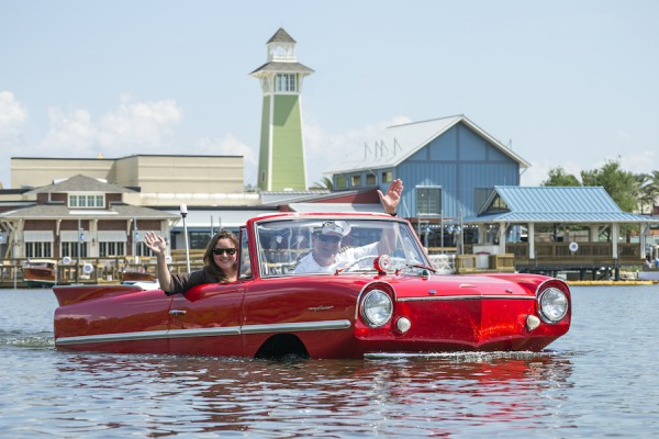 Disney Springs Boathouse red car in water.