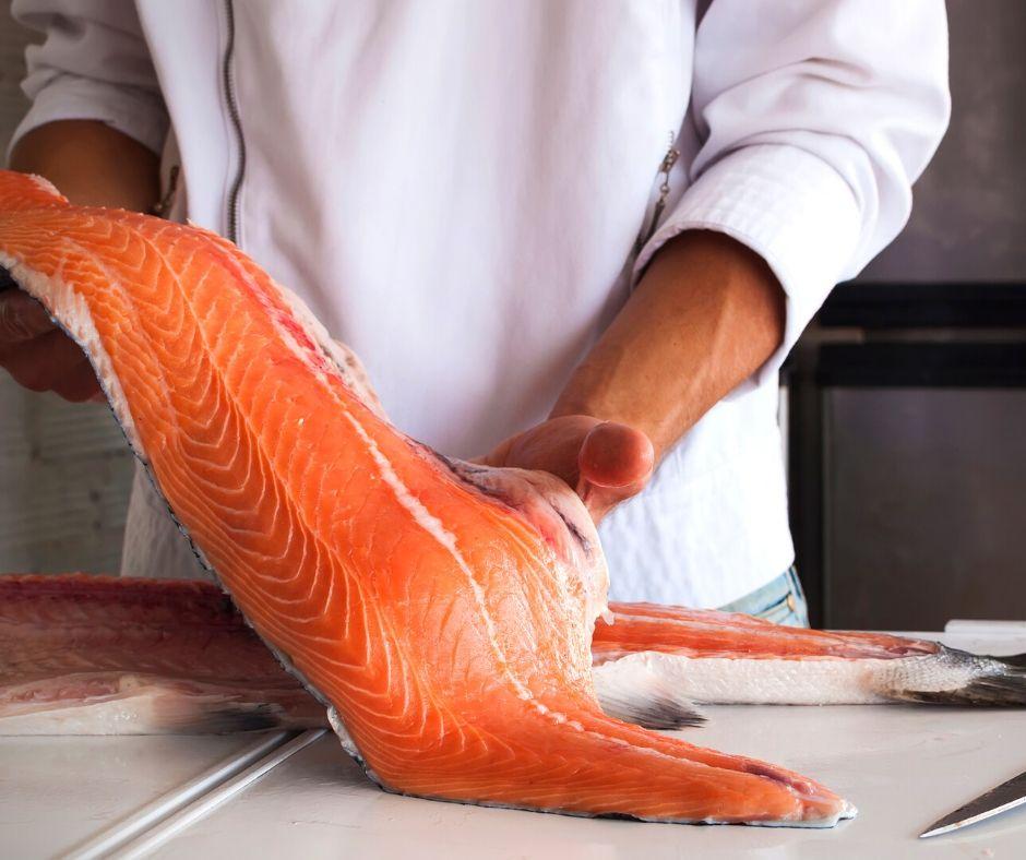 Alaska Copper River Salmon held by chef