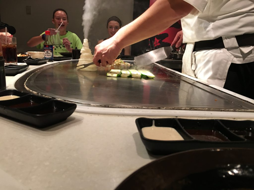 Japan Pavilion at Epcot with onions piled up like a volcano with steam coming out of the top on hibachi top.