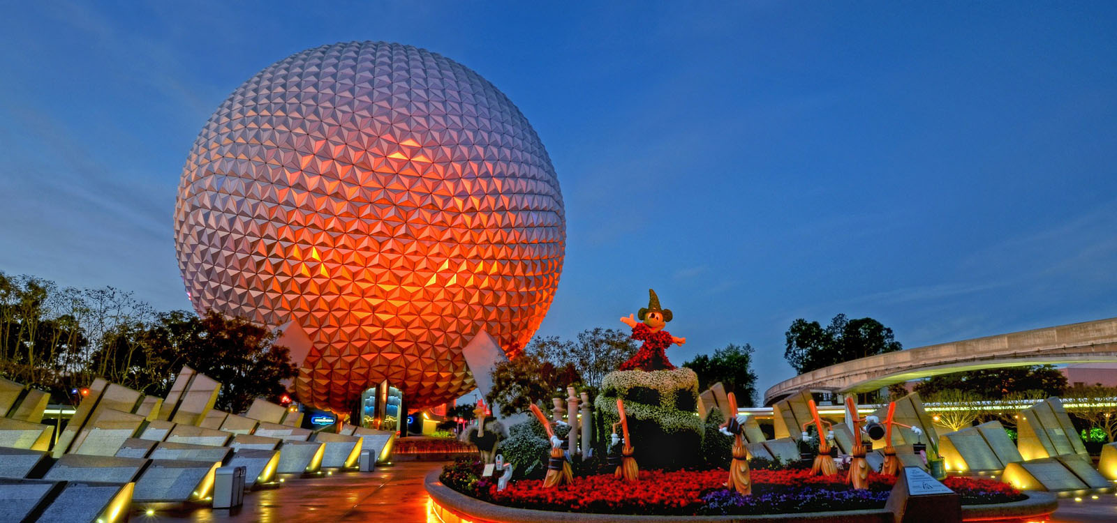 Epcot Hidden Secrets with Spaceship Earth in sunset colors.