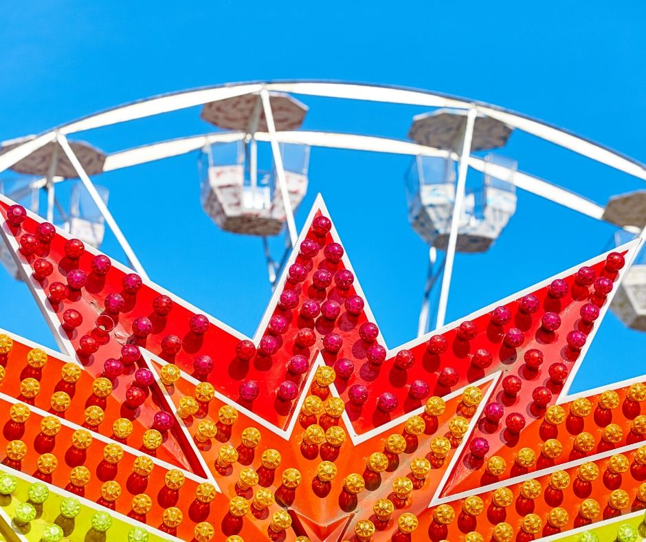 Red Orange and Yellow Ferris Wheel. How to Beat the Florida Heat at Theme Parks