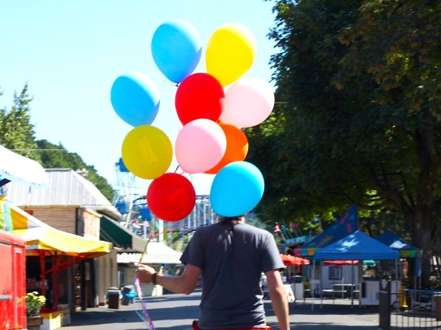 Self-Doubt Quotes with man on bike carrying red, blue, and yellow balloons