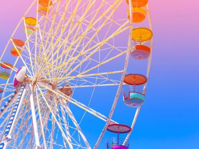 Theme Parks Alone Solo Female Travel with multi-color ferris wheel