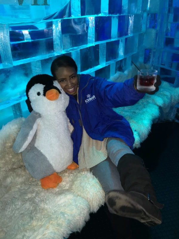 Woman visiting Icebar in Orlando using Groupon discount.