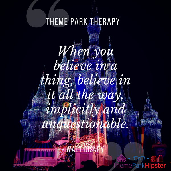 Walt Disney best quote. When you believe in a thing, believe in it all the way, implicitly and unquestionable. With Cinderella Castle covered in bright Christmas lights.