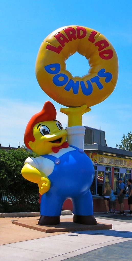 Giant Simpsons Lard Donuts Boy at Universal Studios in front of Cletus' Chicken Shack
