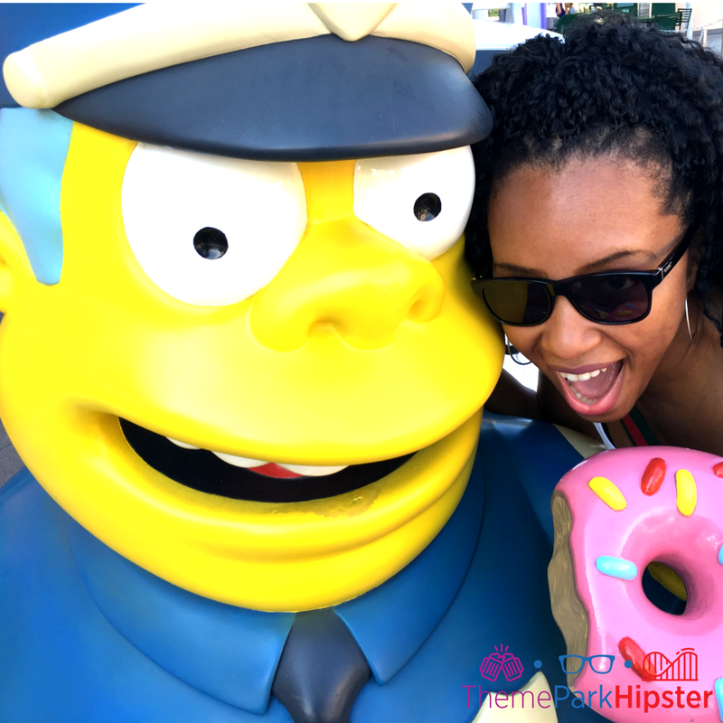 Simpsons Springfield universal studios cop and doughnut with nikky j. One of the best photo spots in Universal Orlando.