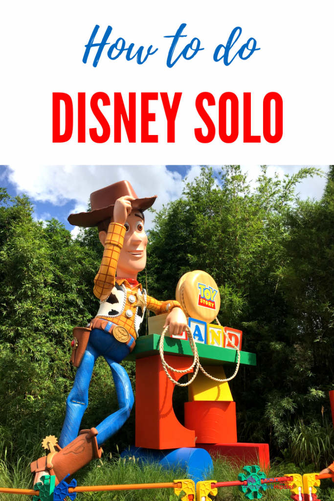 Tips to doing Walt Disney World Solo with Woody of Toy Story Land greeting you.