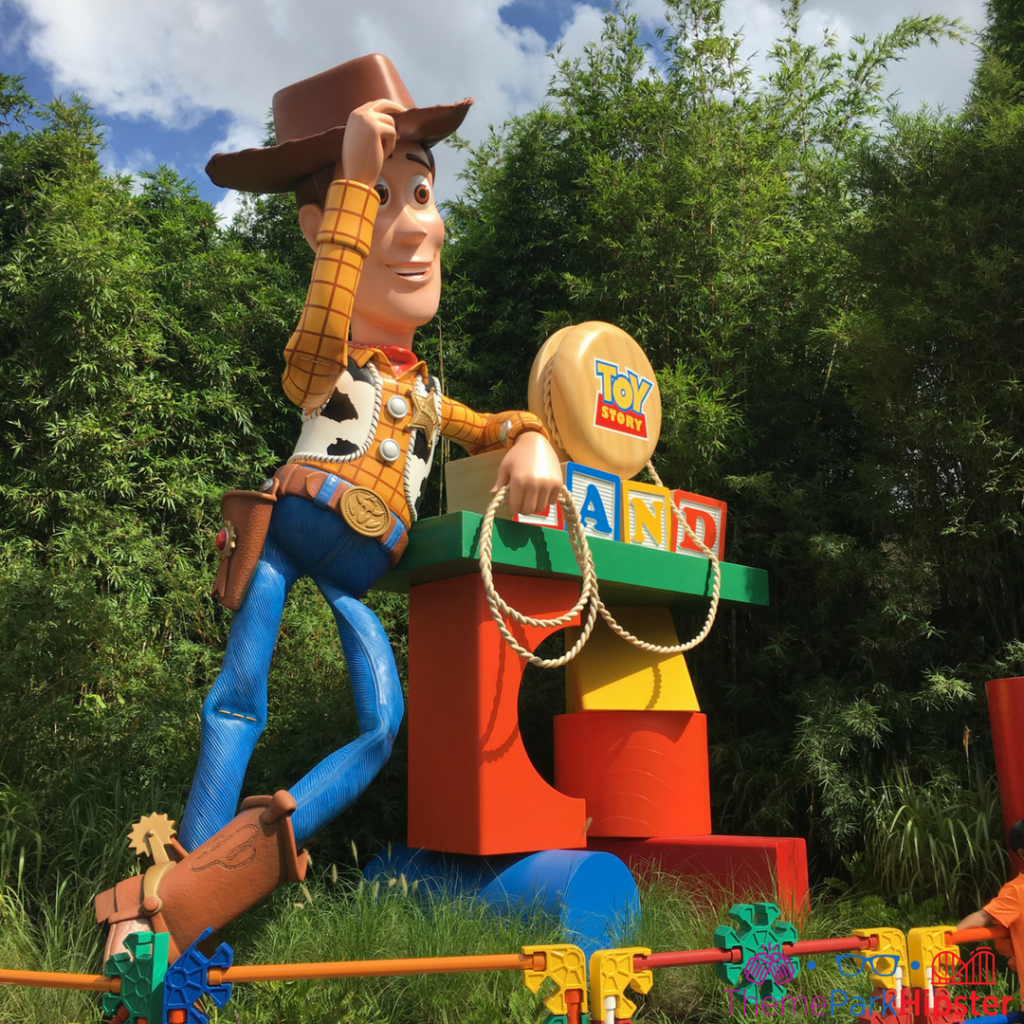 Woody in front of Toy Story Land.