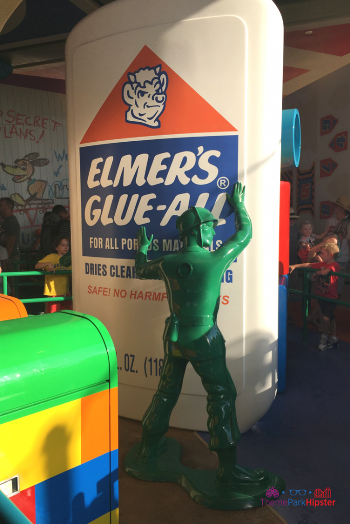 Toy Story Land green army man holding up Elmer's glue.