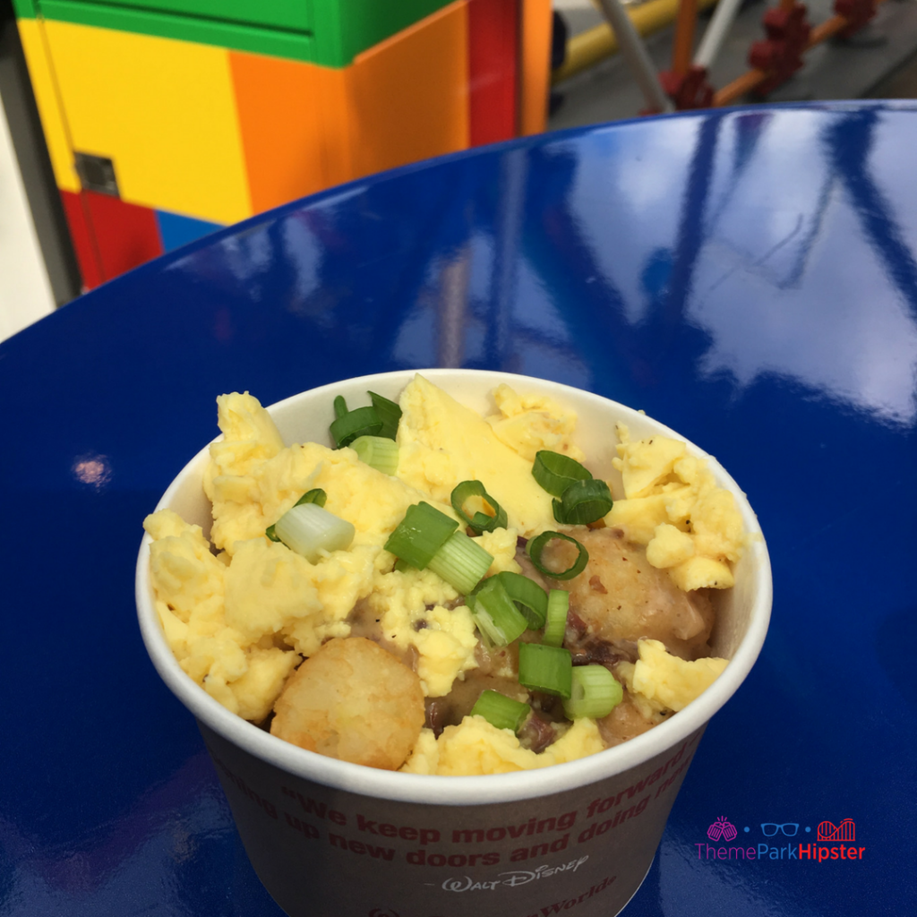Toy Story Land food Breakfast Bowl Hearty portion of Potato Barrels smothered in Smoked Brisket Country Gravy, Scrambled Eggs and a sprinkling of Green Onions