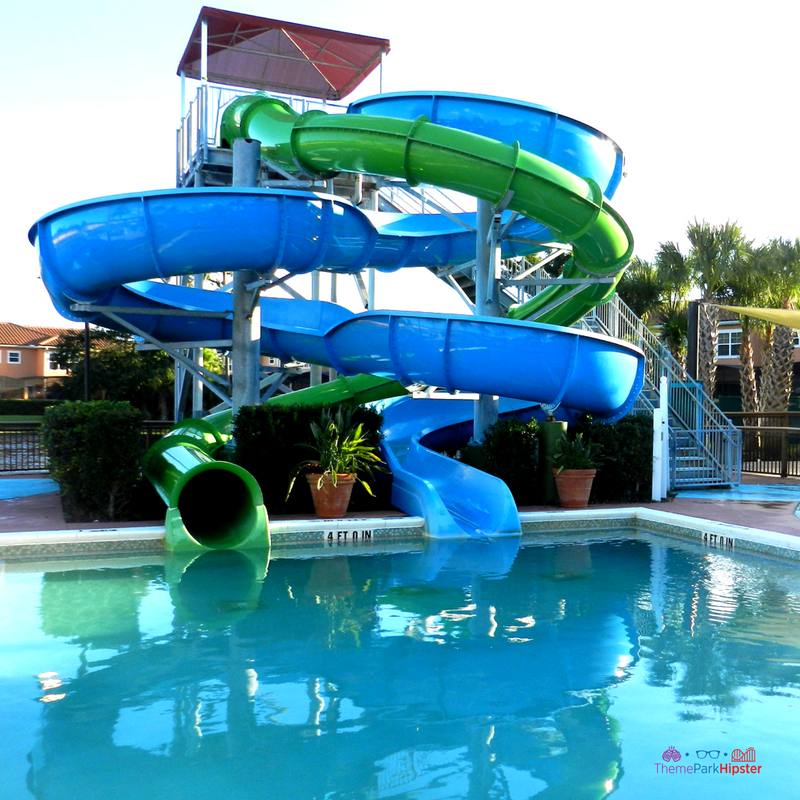 19 reasons you'll love CLC Regal Oaks. Green and blue water slides splashing down into pool.
