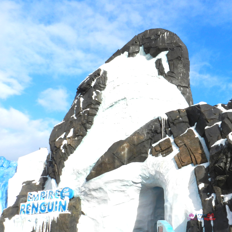 Empire of the Penguin SeaWorld Orlando. Snowy white cap atop a large rock.