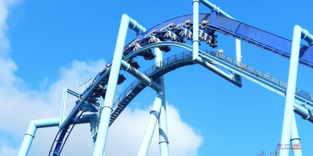 Manta at SeaWorld. A blue tall roller coaster with passengers facing down.