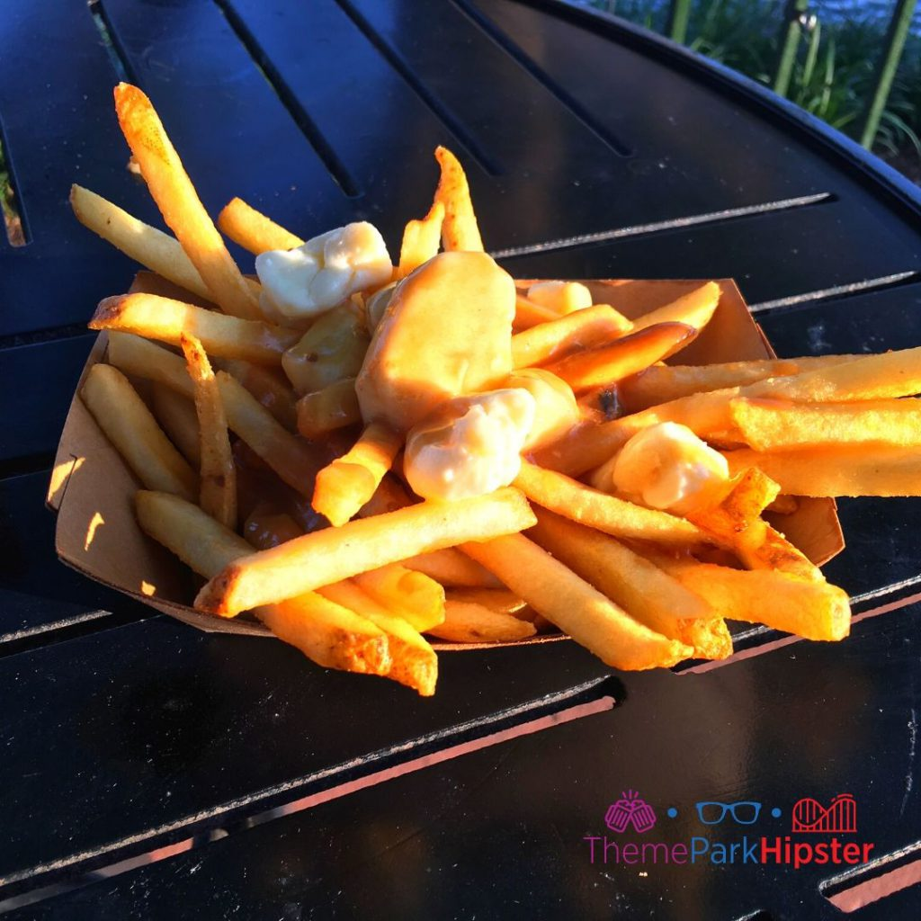 Canada Poutine with Fries Gravy and Cheese Curds on Black Table Available All Year
