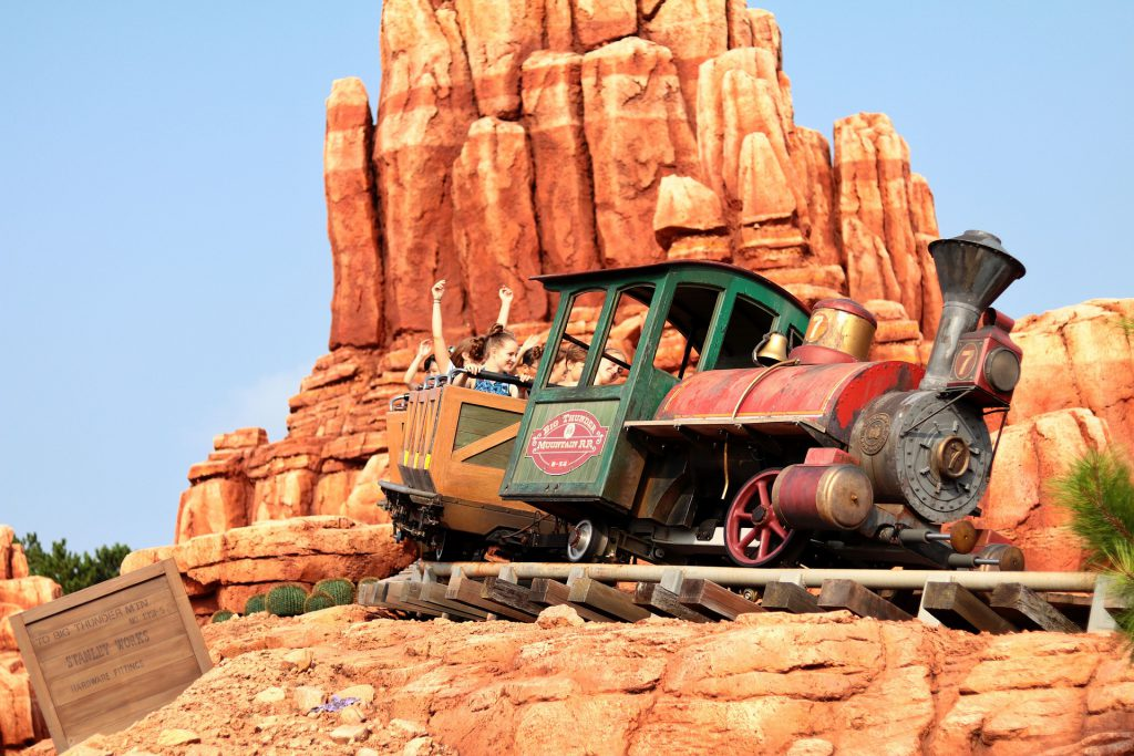 Thunder Mountain Railroad Magic Kingdom Disney Hidden Secrets with golden mountain in the background.